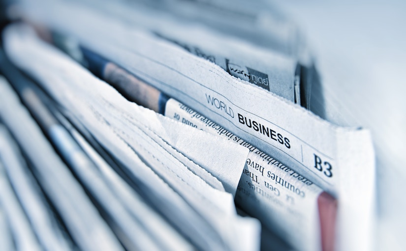 Stack of newspaper that shows the World Business section header.