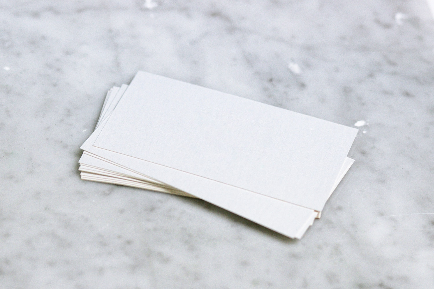 Blank playing cards sitting on a table.
